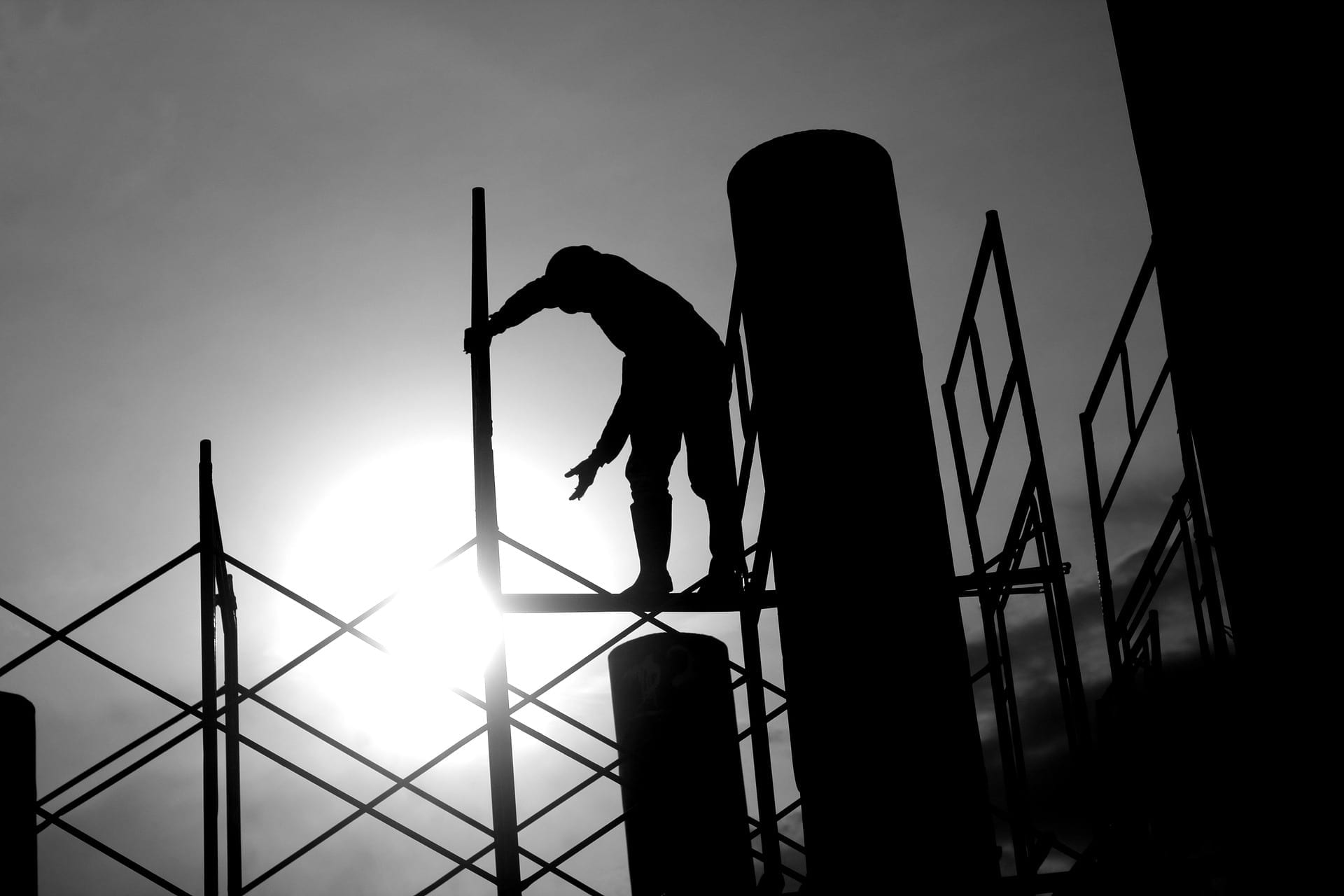 silhouette of construction worker on a scaffold